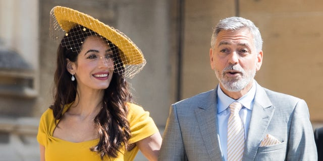 George Clooney and Amal Clooney attend the wedding of Prince Harry to Ms Meghan Markle at St George's Chapel, Windsor Castle on May 19, 2018.