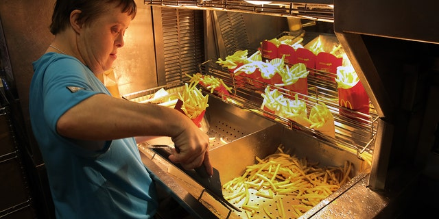 Freia David works the fry station during a retirement celebration.