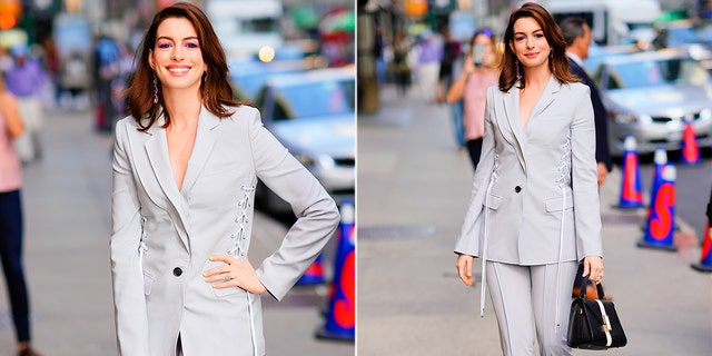 """Anne Hathaway outside the """"The Late Show"""" studio attempting to hide the rip in her pants. The outfit was what the actress originally planned to wear on Tuesday evening."""