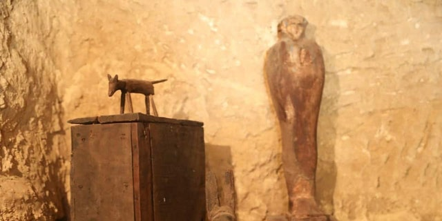 Archaeologists discovered a number of artifacts, including a statue.