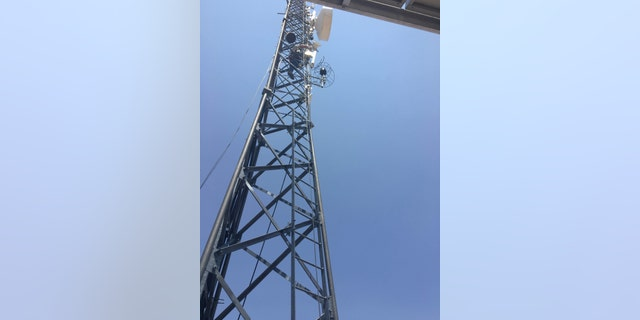 Niles Radio Communications installing an antenna and base station on the Long Mesa tower overlooking Supai, AZ. (MuralNet)