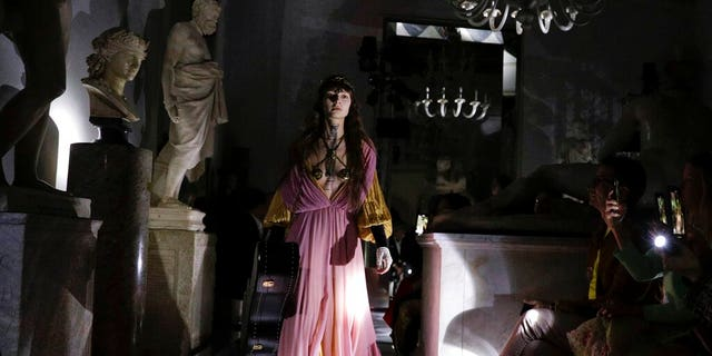 A model wears a creation as part of the Gucci cruise collection that was presented at the Capitoline Museums in Rome.