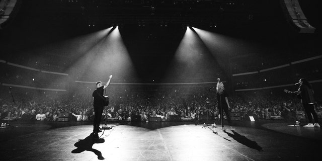 "Bethel Music co-founders Brian and Jenn Johnson lead worship during the ""Heaven Come"" conference in downtown Los Angeles, California."