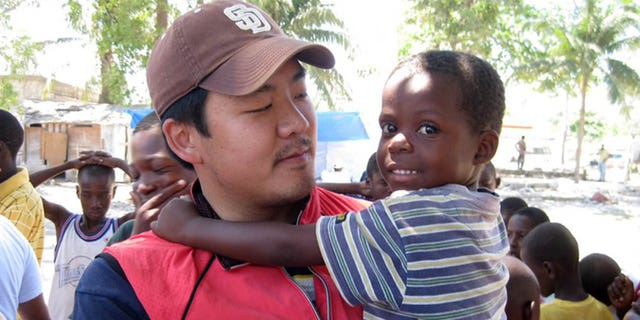 Human rights activist Adrian Hong, seen here in Haiti, was accused in the embassy break-in.
