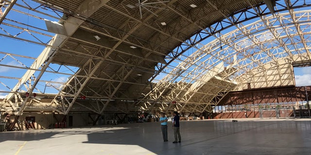 The hangar at Tyndall Air Force Base, shown here, won't be repaired because it would be too costly to do so.