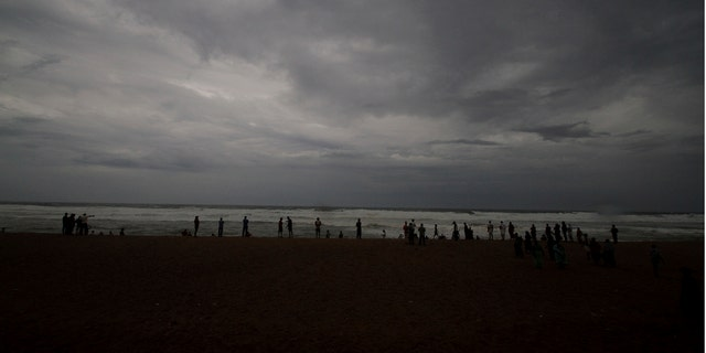 Hundreds of thousands of people were evacuated along India's eastern coast on Thursday as authorities braced for a cyclone moving through the Bay of Bengal that was forecast to bring extremely severe wind and rain.