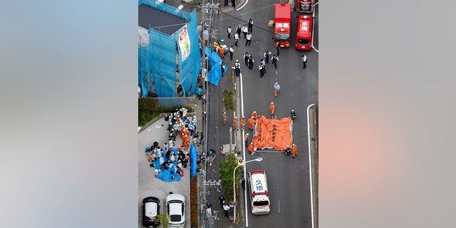 The scene of the attack Tuesday morning in Kawasaki City, Japan. (Jun Hirata/Kyodo News via AP)