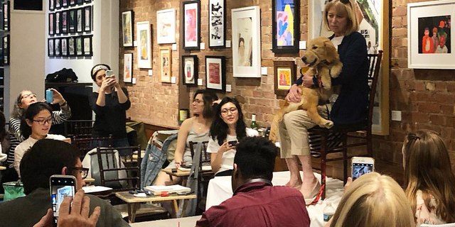 The Canine Companions and their raisers posed for the Society of Illustrators as part of a special event.