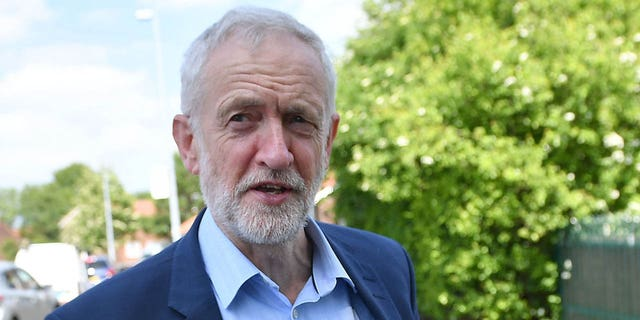 Labour Party leader Jeremy Corbyn views houses with solar panels on Mereside Grove in Worsley on May 16, 2019 in Salford, England. (Getty Images)