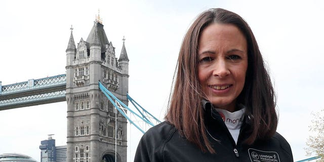 Jo Pavey poses for photographers during a photocall at Tower Hotel, London, ahead of the London Marathon. (Photo by Gareth Fuller/PA Images via Getty Images)