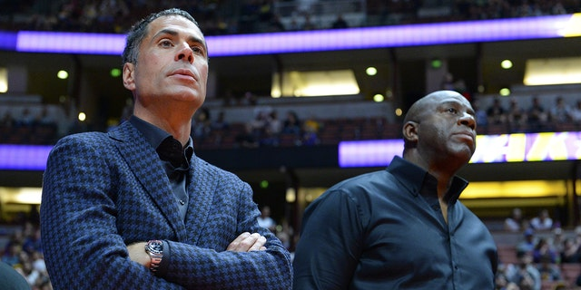 Rob Pelinka, general manager of the Los Angeles Lakers talks to Earvin Magic Johnson, president of basketball operations of the Lakers before the game against the Minnesota Timberwolves on September 30, 2017 at the Honda Center in Anaheim, California. (Photo by Robert Laberge/Getty Images)