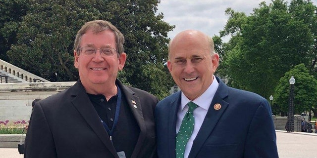 Keith Davidson, director of the U.S. Capitol Bible Marathon, and Rep. Louis Gohmert, R-Texas.