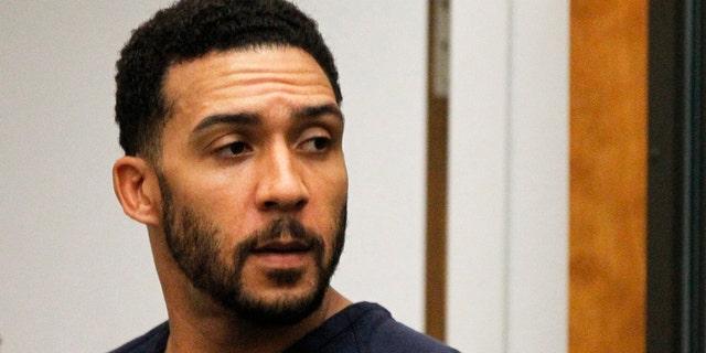 FILE - Former NFL football player Kellen Winslow Jr., center, leaves his arraignment in Vista, Calif. AP/Pool