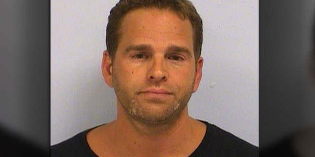Kyle Gerald Prall, 40, pleaded guilty to one count of mail fraud after admitting that in 2015 and 2016 he created several political action committees and falsely advertised that contributions would support the presidential candidates during the 2016 election, the Department of Justice said Thursday. He is pictured here after being charged on July 15, 2015, with driving while intoxicated.