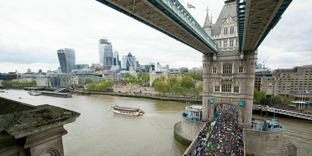 A British nurse who ran the London Marathon in her uniform said she was denied a Guinness World Records listing because she wasn't wearing a skirt, only scrubs.