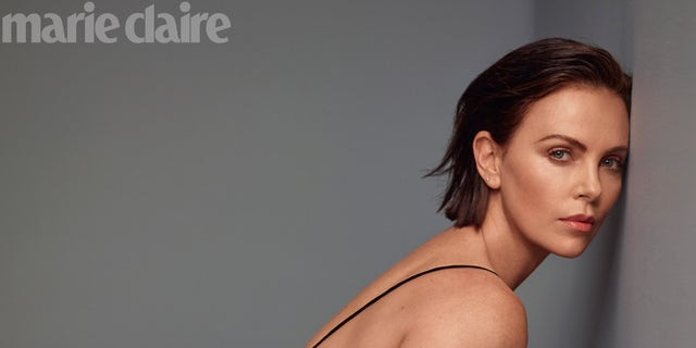 Charlize Theron opened up about motherhood and therapy.