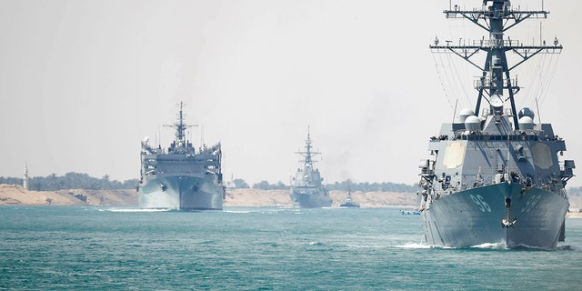 In this Thursday, May 9, 2019 photo released by the U.S. Navy, the Abraham Lincoln Carrier Strike Group transits the Suez Canal in Egypt. (Mass Communication Specialist 3rd Class Darion Chanelle Triplett/U.S. Navy via AP)