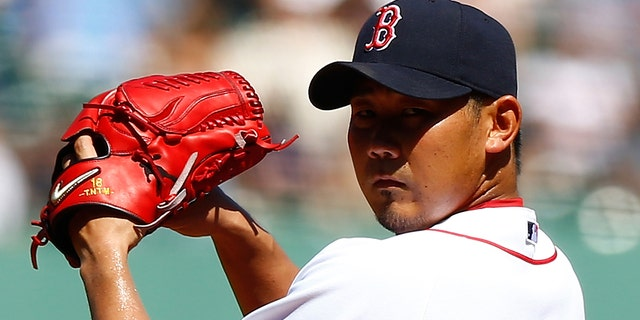 Daisuke Matsuzaka #18 of the Boston Red Sox pitches against the Kansas City Royals during the game on August 27, 2012 at Fenway Park in Boston, Massachusetts. (Photo by Jared Wickerham/Getty Images)