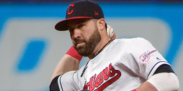 Cleveland Indians' Jason Kipnis throws out Seattle Mariners' Domingo Santana during the sixth inning of a baseball game in Cleveland, Friday, May 3, 2019. (AP Photo/Phil Long)