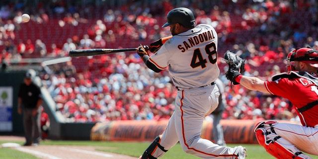 San Francisco Giants' Pablo Sandoval hits a three-run home run off Cincinnati Reds starting pitcher Anthony DeSclafani in the sixth inning of a baseball game, Monday, May 6, 2019, in Cincinnati. (AP Photo/John Minchillo)