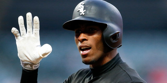 Chicago White Sox's Tim Anderson gestures to the dugout after being walked by Cleveland Indians starting pitcher Jefry Rodriguez during the sixth inning of a baseball game, Tuesday, May 7, 2019, in Cleveland. (AP Photo/Ron Schwane)