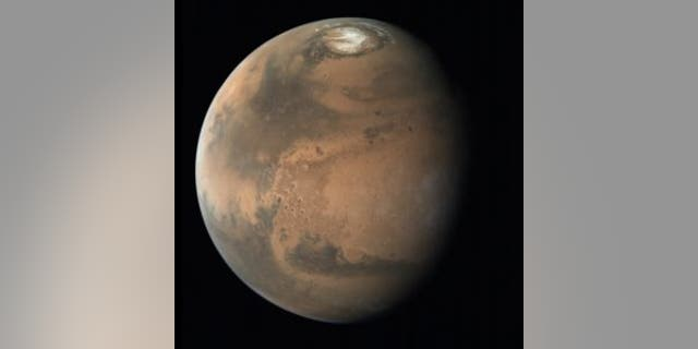 A view of Mars that shows the Red Planet's northern polar ice cap.