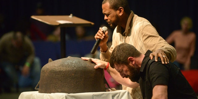 Will Ford and Matt Lockett pray with in the same posture as Ford's ancestors who prayed that one day the next generation or the one after would know freedom.