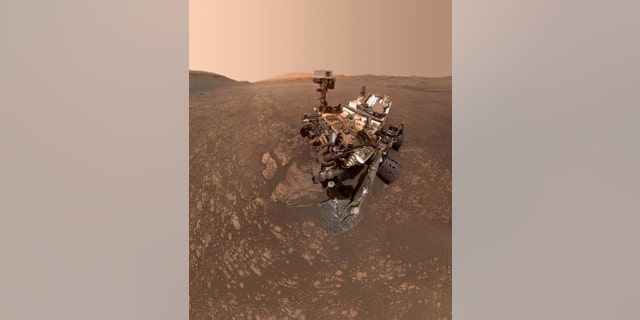 """NASA's Curiosity Mars Rover Finds a Clay Cache NASA's Curiosity Mars rover took this selfie on May 12, 2019 (the 2,405th Martian day, or sol, of the mission). To the lower-left of the rover are its two recent drill holes, at targets called """"Aberlady"""" and """"Kilmarie."""" (Credit: NASA/JPL-Caltech/MSSS)"""
