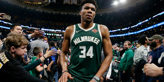 Milwaukee Bucks' Giannis Antetokounmpo leaves the court after defeating the Boston Celtics in Game 4 of a second-round NBA basketball playoff series in Boston, Monday, May 6, 2019. (AP Photo/Michael Dwyer)