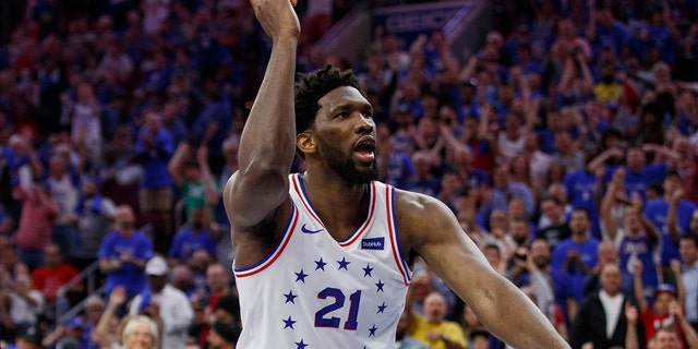 Philadelphia 76ers' Joel Embiid reacts to his dunk during the second half of Game 3 of the team's second-round NBA basketball playoff series against the Toronto Raptors, Thursday, May 2, 2019, in Philadelphia. The 76ers won 116-95. (AP Photo/Chris Szagola)