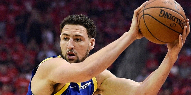 Golden State Warriors guard Klay Thompson, right, looks to pass as Houston Rockets guard Chris Paul defends during the first half of Game 3 of a second-round NBA basketball playoff series, Saturday, May 4, 2019, in Houston.