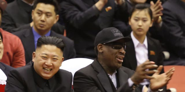 North Korean leader Kim Jong Un and former NBA star Dennis Rodman share a laugh during Rodman's visit to North Korea in 2013.