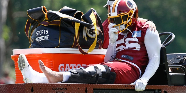 Washington Redskins linebacker Reuben Foster rides a cart off the field after suffering an injury during a practice at the team's NFL football practice facility. (AP Photo/Patrick Semansky)