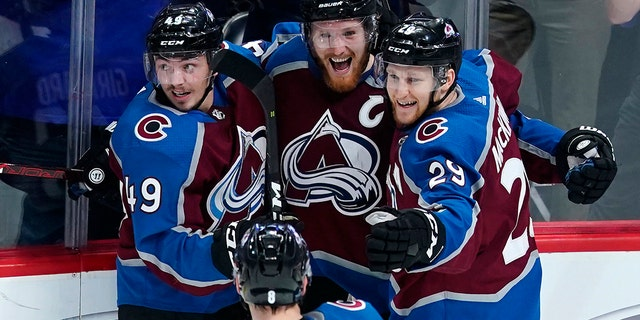 Colorado Avalanche left wing Gabriel Landeskog (92) is congratulated by teammates Samuel Girard (49), Nathan MacKinnon (29) and Cale Makar (8) after scoring a game-winning, overtime goal against the San Jose Sharks in Game 6 of an NHL hockey second-round playoff series, Monday, May 6, 2019, in Denver. Colorado won 4-3 in overtime. (AP Photo/Jack Dempsey)
