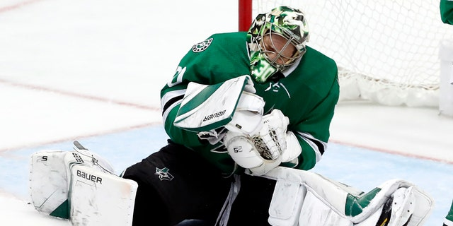 Dallas Stars goaltender Ben Bishop reacts after being hit by a puck during the third period in Game 6 of an NHL second-round hockey playoff series against the St. Louis Blues, Sunday, May 5, 2019, in Dallas. (AP Photo/Tony Gutierrez)