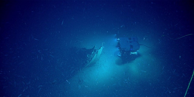 The Remotely Operated Vehicle (ROV) Deep Discoverer approaching the shipwreck's bow. (Image courtesy of the NOAA Office of Ocean Exploration and Research)