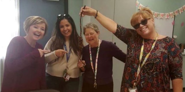 Photo shows Palmdale teachers smile while holding noose