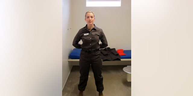 Master-at-Arms 2nd Class Neah Rau, corrections specialist, Naval Consolidated Brig Chesapeake, models the new pre-trial standardized prisoner uniform.