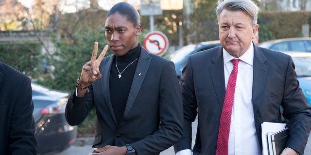 Caster Semenya, left, current 800-meter Olympic gold medalist and world champion, and her lawyer Gregory Nott, right, arrive for the first day of a hearing at the international Court of Arbitration for Sport, CAS, in Lausanne, Switzerland. (Laurent Gillieron/Keystone via AP, File)