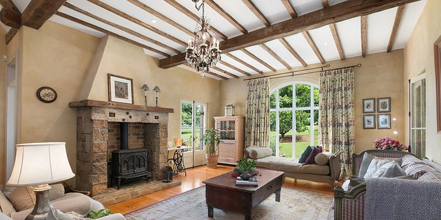 """The property's """"French-inspired countryresidence""""features exposed wood beams and stone archways."""