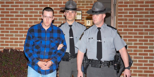 Thomas Dewald is escorted by Pennsylvania State troopers Monday night, April 29, 2019 after being charged in two recent cases in the Rouzerville, Pa. area.