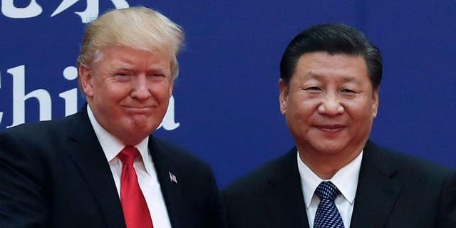 President Trump and China's President Xi Jinping, seen in an undated photo, are scheduled to meet later this month in Japan.