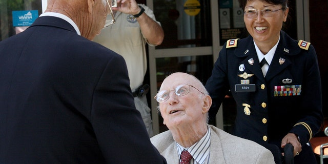 Gen. Lloyd Ramsey, right, reunites with Robert Maxwell, left, at the Brandon Oaks Assistant Living Center in Roanoke, Va. The two had not seen each other since Maxwell threw his body on to a grenade during WWII, saving the lives of Ramsey and several others. (AP Photo/The Roanoke Times, Matt Chittum)