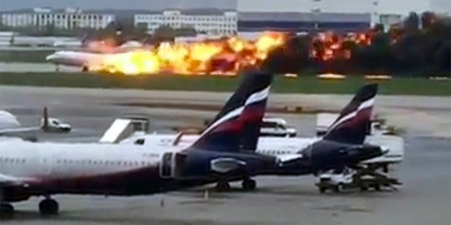 This image taken from video provided by Instagram user @artempetrovich, shows an Aeroflot Airlines flight on fire during an emergency landing in Sheremetyevo airport in Moscow, Russia.