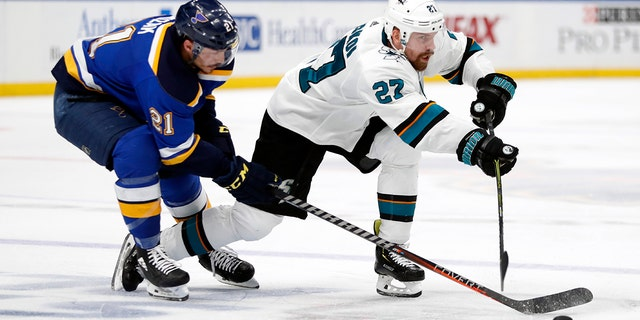 San Jose Sharks right wing Joonas Donskoi (27), of Finland, passes the puck away from St. Louis Blues center Tyler Bozak (21) during the second period in Game 6 of the NHL hockey Stanley Cup Western Conference final series on Tuesday in St. Louis. (Associated Press)