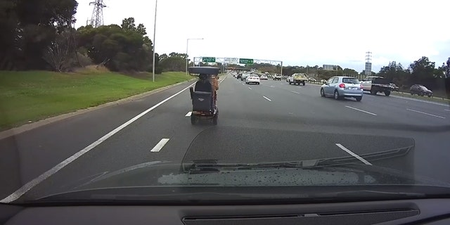 A 92-year-old man was seen on a dashcam video driving his mobility scooter onto a busy freeway in the suburbs of Melbourne, Australia on Friday.
