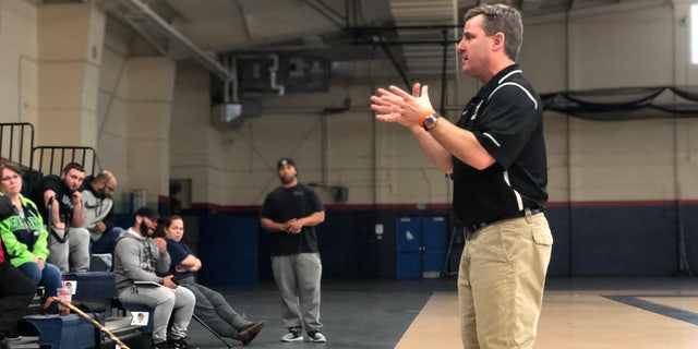 U.S.A. Football Master Trainer Scott Taylor explains to coaches how to prevent concussions on the field.