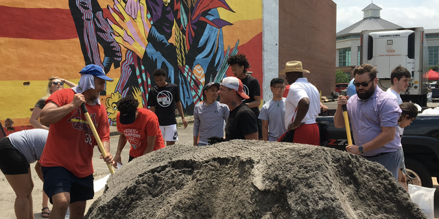 """""""I'm very happy to be here and help my community,"""" Ordonez said. """"I encourage everybody to come and help us because this is the time that as a city we need to come together and help each other. And with the help of God, we're gonna make it."""""""