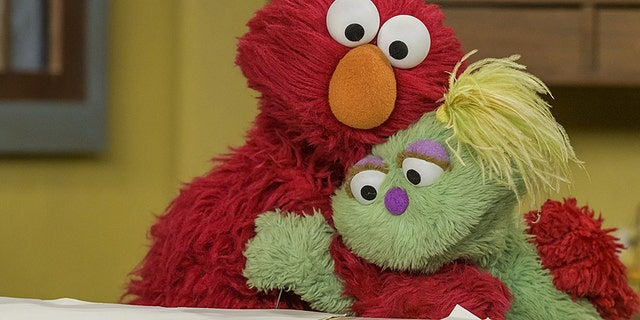 Karli is a young, green Muppet in foster care.