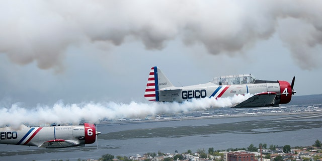 The Geico Skytypers fly a restored SNJ-2 plane -- also called a T-6 Texan by the Army Air Corps -- that originally was produced to train Allied pilots during World War II. Each plane is equipped with a system that can release streams of smoke to 'type' messages in the sky.